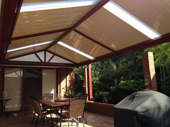Gable patio with C-Dek roofing in a perfect garden setting