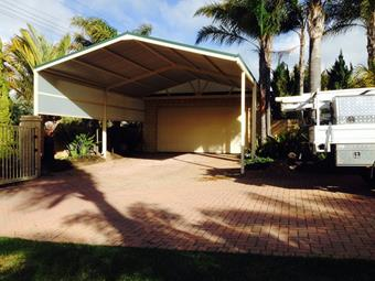 Large gable carport with privacy screen