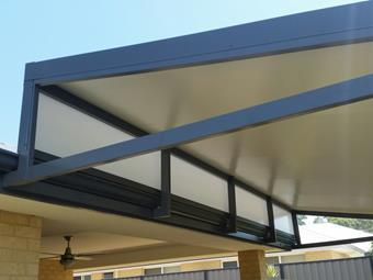 Raised flat patio with solarspan roofing and sunlite endfill.