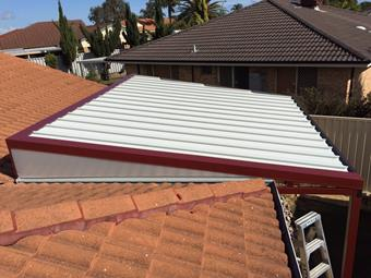 Raised flat patio with c-dek roofing and sunlite endfills