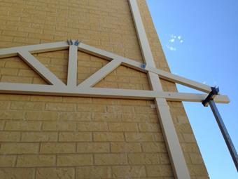 Gable truss knotched out around downpipe