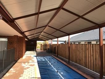 a custom gable patio over pool