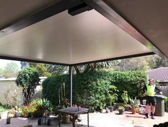 a raised flat patio in solarspan by great aussie patios