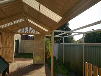 Gable patio in classic cream with lattice ends and open frame to the side.