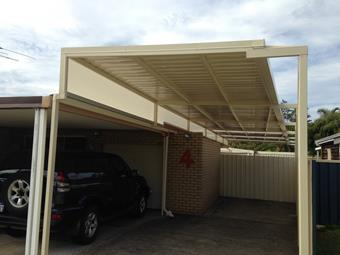 Raised flat carport through to rear of home