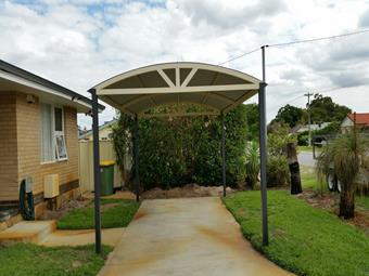 Freestanding dome carport