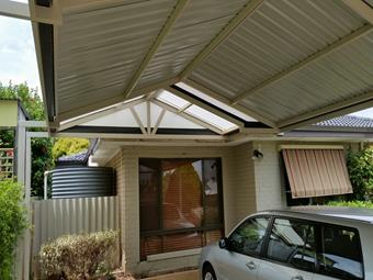 Gable carport with post extensions to boundary