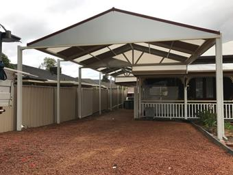 a custom gable carport and patio