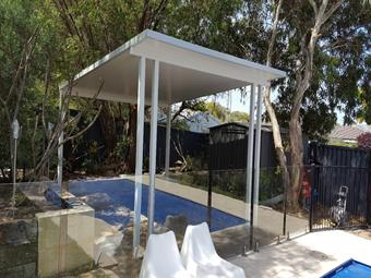 free standing flat patio with solarspan roofing