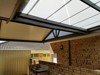 Multicell flat patio joining a solarspan gable