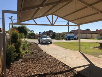 a gable carport with post extensions