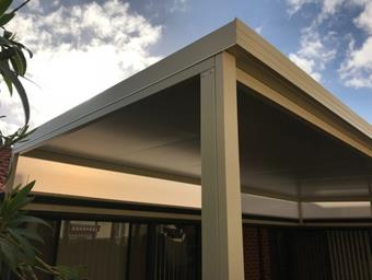 a custom solarspan raised flat patio by great aussie patios