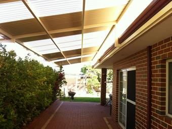 raised flat patio with polycarbonat skylights and sunlite infill